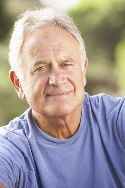 Portrait Of Senior Man Relaxing In Countryside